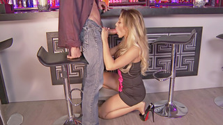 Busty blonde Capri Cavanni gives head in the bar